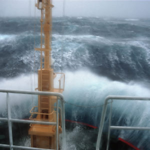 Crossing Drake's Passage. Waves crashing over the bow of the RRS Ernest Shackleton during a Force 12 storm.