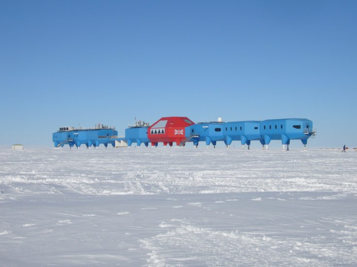 Landscape image of Halley VI station in the background, and the brunt ice-shelf in the foreground.