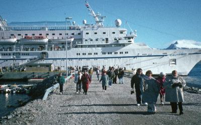 Tourists walk ashore at Ny Alesund on Svalbard