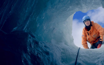 Looking up to a BAS Field assistant through a deep hole in the ice