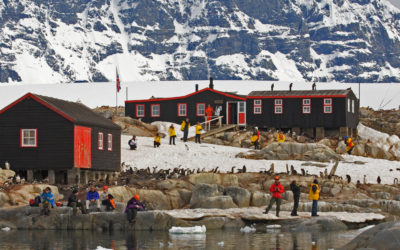 Tourists visit the historical British Station on Port Lockroy, just off the  Antarcrtic Peninsula