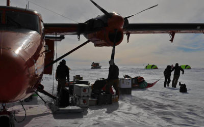 Unloading science kit from a BAS Twin-Otter aircraft at the SLE field site