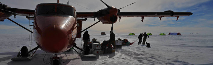 Unloading science kit from a BAS Twin-Otter aircraft at deep-field site