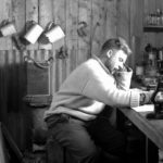 Norman Marshall (zoologist) working in laboratory at Base D, Hope Bay, 1945. (Photographer: Ivan Mackenzie Lamb; Archives ref: AD6/19/1/D194)