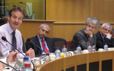 Chris davies et al. sitting at a table.