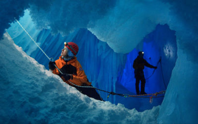 A woman and a man in an ice cave