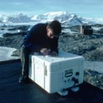 SAOZ - observes spectra of UV and visible sunlight scattered from the zenith sky at twilight, to measure total column ozone and Nitrogen dioxide. SAOZ (Systeme d'Analyse d'Observations zenithales) is in a weather-proof box and looks up through the simple quartz window in its lid. Derek Oldham is seen here installing SAOZ on the roof of the ozone loft in March 1990. Faraday station was occupied by BAS from 1947 to 1996, it was transferred to the Ukraine in February 1996 and renamed Vernadsky. SAOZ was moved to Rothera when Faraday was transferred to the Ukraines