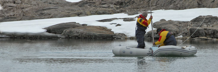BAS scientists extracting a sediment core from a remote lake on Horseshoe Island, Antarctic Peninsula. The climate record in this core will cover approx' 20,000 years.