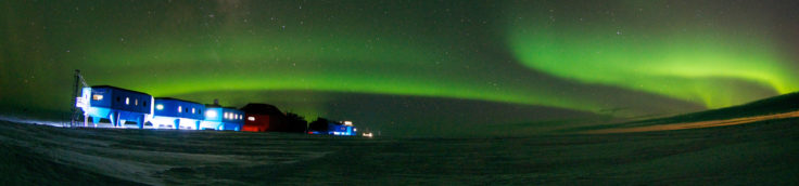 Winter image of the Halley VI Research Station on the Brunt Ice Shelf in Antarctica with aurora