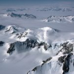 Mountains and glaciers of the Antarctic Peninsula from the air.