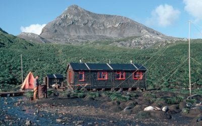 A hut in front of a mountain