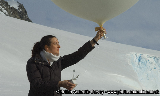 A scientist prepares to launch a meteorological balloon at Rothera Research Station, Antarctica