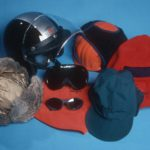 Antarctic Clothing Pictures Head gear: Upper, Skidoo Helmet, Insulated safety helmet, Fleece balaclava, lower: Fur Field Hat, Glacier Glasses and Goggles resting on Fleece Neck Tube, Field Hat.