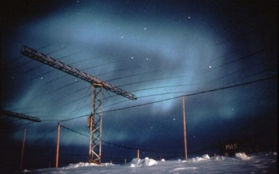 Structured and coloured Aurora above Halley base with the SHARE caboose and Antenna Array in foreground. Log-periodic antenna system of the Southern Hemisphere Antarctic Radar Experiment (SHARE) formerly called Polar Anglo-American Conjugate Experiment (PACE). SHARE uses high frequency backscatter radar to investigate the structure and dynamics of the ionosphere from the ground.