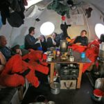 The team relaxing in the Melon hut after a long day working to fly equipment to Ellsworth Lakes