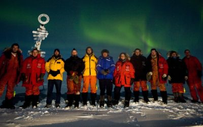The Halley Winterers below a mid-winter aurora.