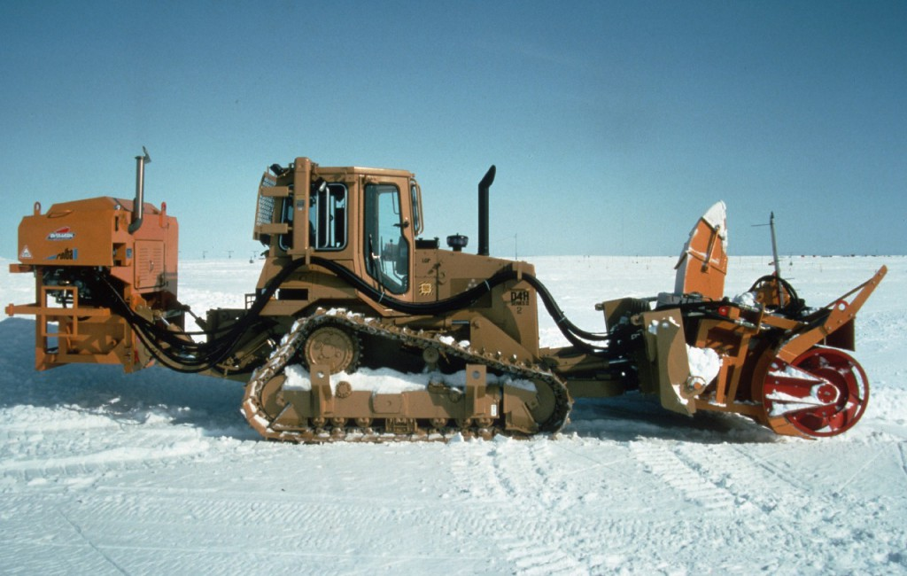 Caterpillar D4 complete with snow blowing equipment