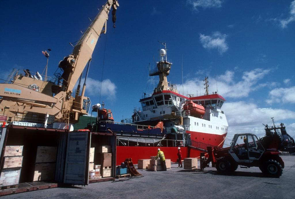 RRS Ernest Shackleton loading cargo at Maire Harbour, Falkland Islands
