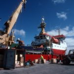 RRS Ernest Shackleton loading cargo at Maire Harbour, Falkland Islands