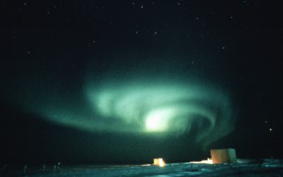 Convoluted auroral curtain.  Aurora are caused by the precipitation of charged particles from space towards the magnetic poles driven by plasma winds and magnetic storms.