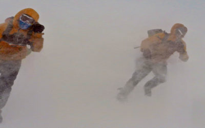 People walking through a blizzard