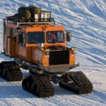 Sno-cat parked outside the Laws building. Halley research station