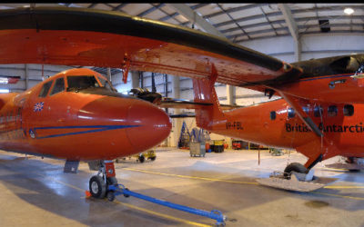 Orange aircraft in a hanger
