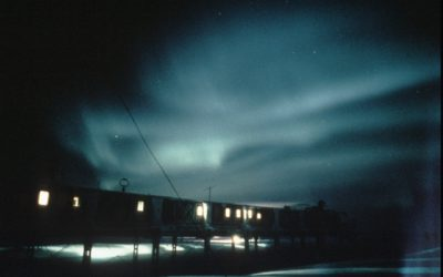 Aurora over ACB.  Aurora are caused by the precipitation of charged particles from space towards the magnetic poles driven by plasma winds and magnetic storms.