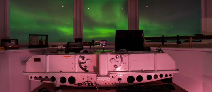 The Dobson Ozone Spectrophotometer used to measure ozone from the ground at Halley VI Research Station with the impressive Aurora Australis display in the background. (Photo: Tom Welsh)