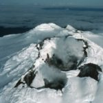A close up of a snow covered mountain.