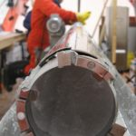 A core of ice in the drill barrel at the James Ross Island drilling project. This ice forms part of a 364 metre long record of ice recovered from the ice cap on top of James Ross Island. This is the first deep ice core collected from the northern part of the Antarctic Peninsula, and one of only a handful of Antarctic ice cores that has reached the bedrock beneath the ice.