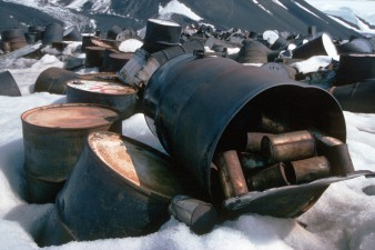 Old fuel drums and food tins at fossil Bluff waste dump before removal from Antarctica in the summer of 1994/5