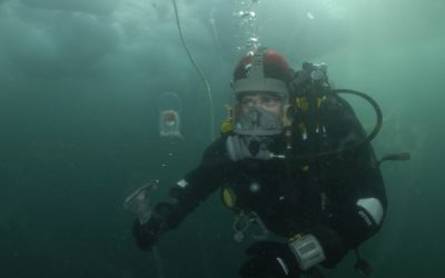 Diver wearing a full face AGA mask. Near Rothera Research Station.