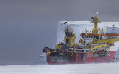 RRS Ernest Shackleton alongside sea ice, next to the Brunt Ice Shelf in the Weddell Sea during Halley station relief