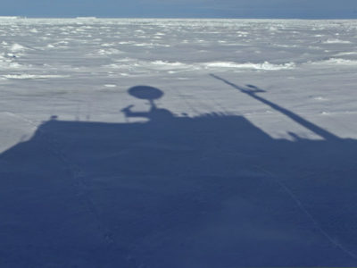 The shadow of RRS James Clark Ross seen on the vast sea ice expanse.