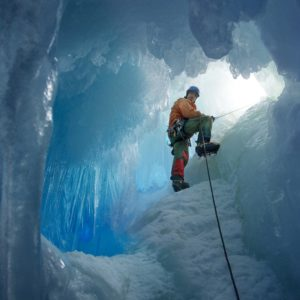 British Antarctic Survey field assistant Rob Smith enters a crevasse alongside Reptile Ridge on Adelaide Island, Antarctica