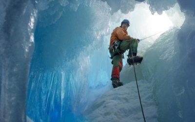 British Antarctic Survey field assistant Rob Smith enters a crevasse alongside Reptile Ridge on Adelaide Island, Antarctica