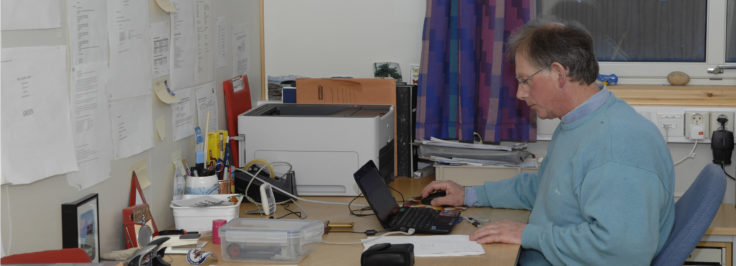 UK Arctic Station Leader Nick Cox in the office at Ny-Ålesund