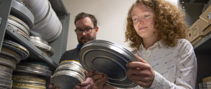 Ieuan and Alysa looking through the valuable film archives in the controlled environment in the archive at BAS Cambridge