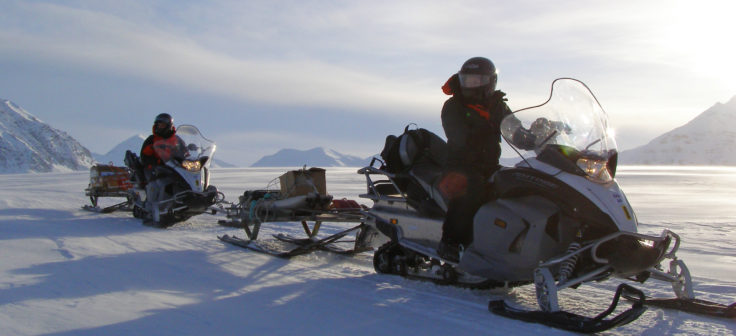 Skidoos being used for travel to Scientific research sites on Svalbard