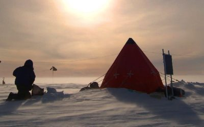 A BAS camp of small tents in an icy landscape