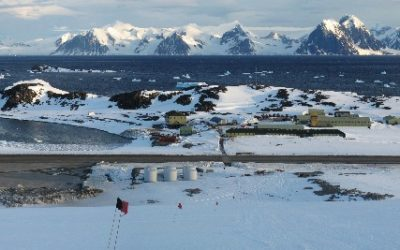The view looking East, across Rothera Research Station, towards the Antarctic Peninsula as seen from the top of 'the ramp' above the station. This image shows the whole of the reserch Station from the Hangar (lower left) to the wharf where you can sea the BAS ship the RRS James Clark Ross (on the right)