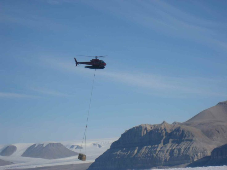 Using a helicopter to deploy equipment into the deep field