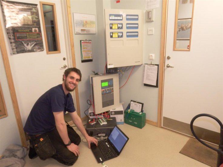 Robbie Scott updating the fire alarm system at Bird Island