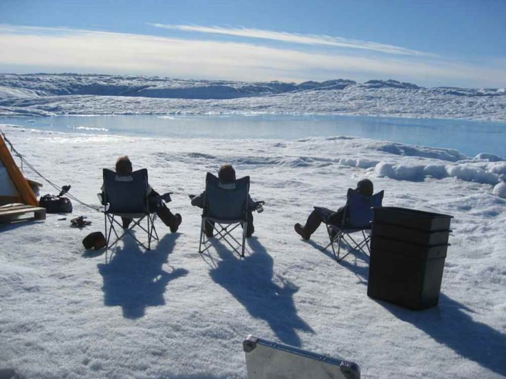 Working in the deep field, Petermann ice shelf, NW Greenland - scientists take a moment to enjoy the beauty of their surroundings