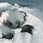 Cinder cones and volcanic steam at Mount Sourabaya, Bristol Island, South Sandwich Islands.