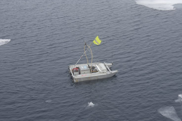 Launching the remote controlled sampling boat in Arctic waters (Josh Griffiths, University of Bangor)