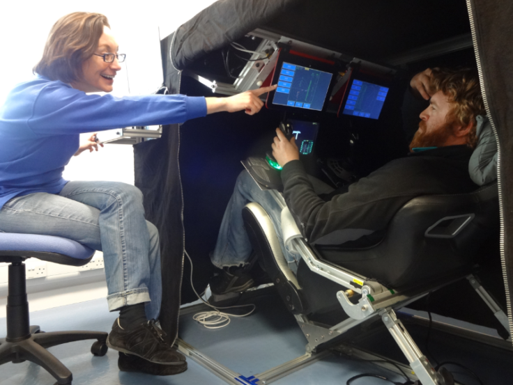 Doctor Nathalie Pattyn testing the spaceflight simulator with a winter team member