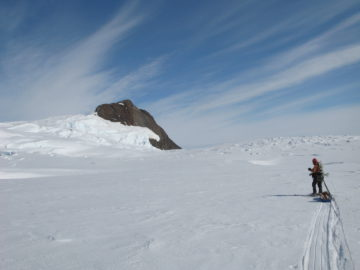Jo's Field Assistant Iain Rudkin skiing towards Dorrel Rock