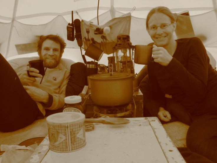 Jo and Iain enjoy a cup of tea in their tent